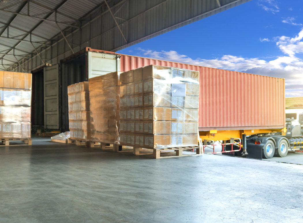 Large Shipments Pallet Goods Waiting for Load Into Container Truck at Warehouse Dock