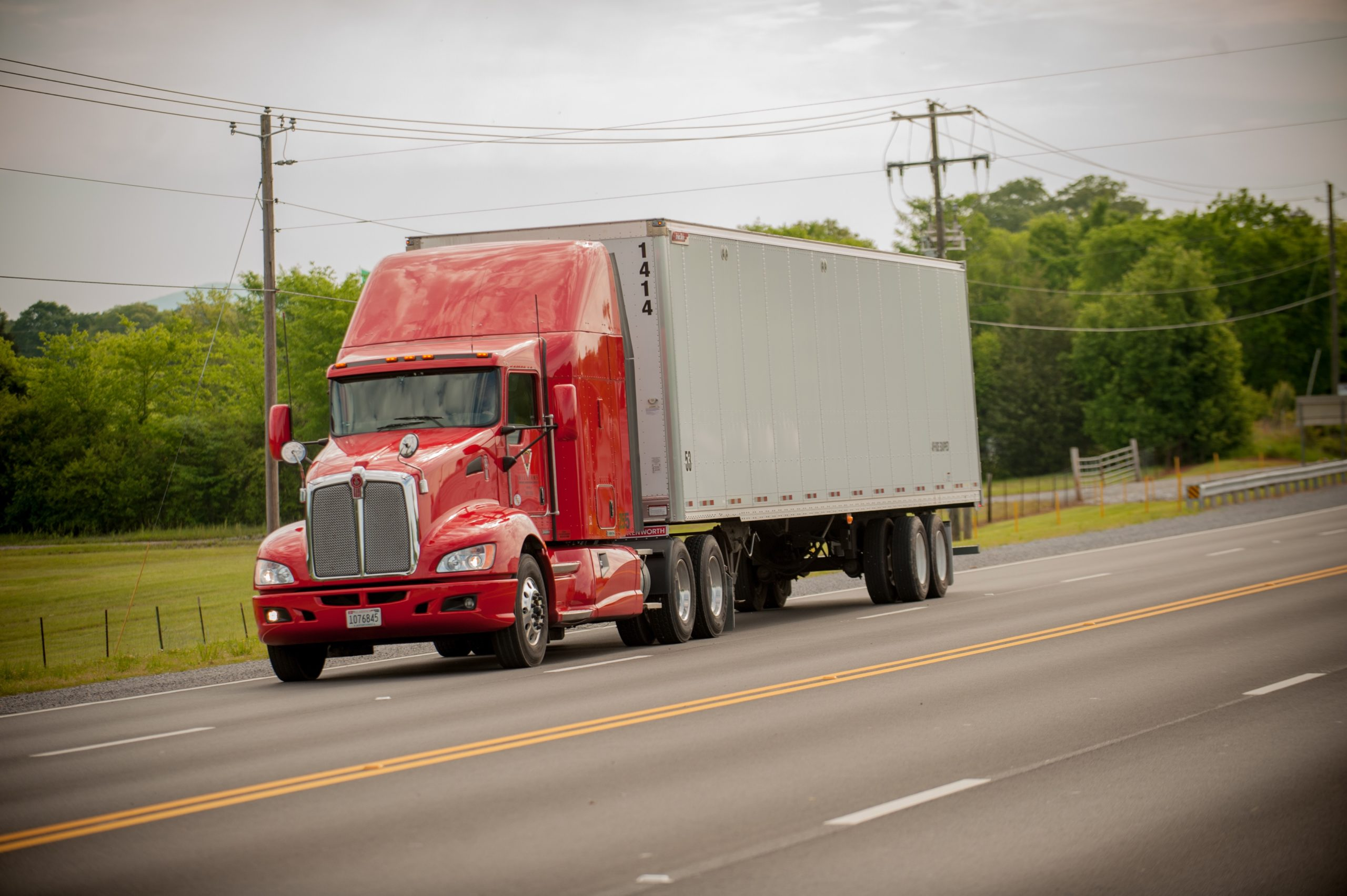 Inbound and Outbound Logistics Truck en Route on Highway